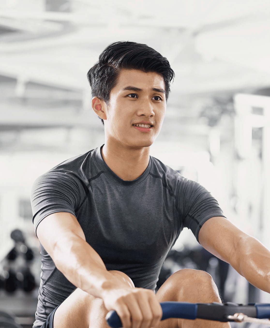 Man doing rowing maching at a gym